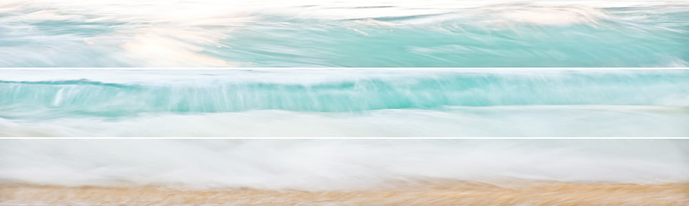 panoramic shot of waves on seashore