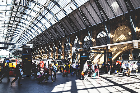 Train passengers at a busy railway station at Kings Cross in Central London. Image captured with a Canon 6D DSLR