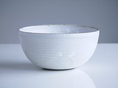 white bowl on white panel