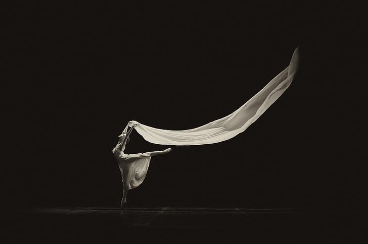 ballerina holding white textile