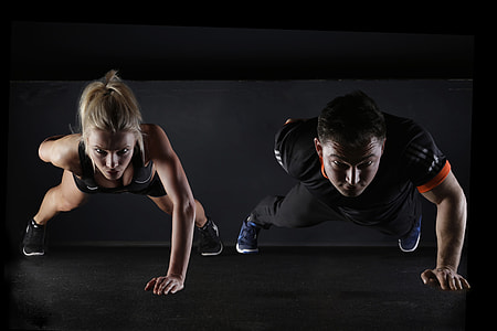 Fitness couple doing working out exercises in the gym