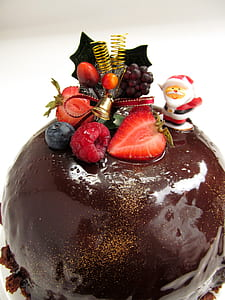 round chocolate coated cake with berry topping