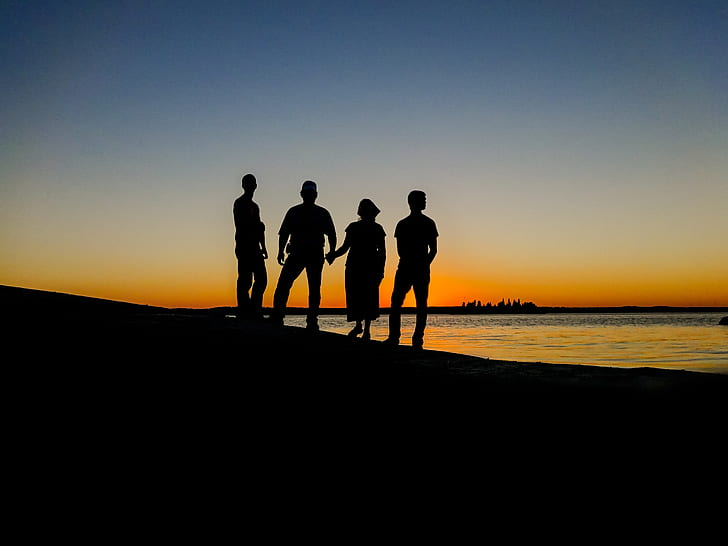 Royalty-Free photo: Silhouette of four people standing