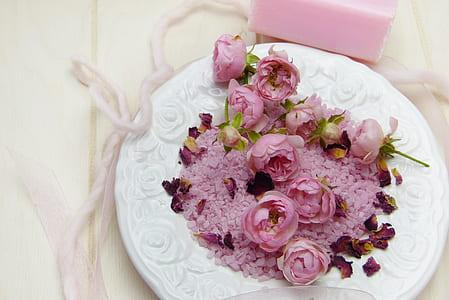 purple multi-petaled flowers on round white ceramic plate
