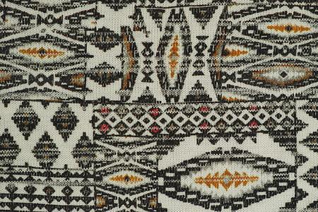 white, gray, and yellow aztec textile
