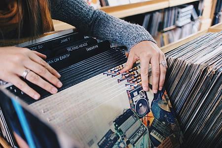 woman filing record sleeves