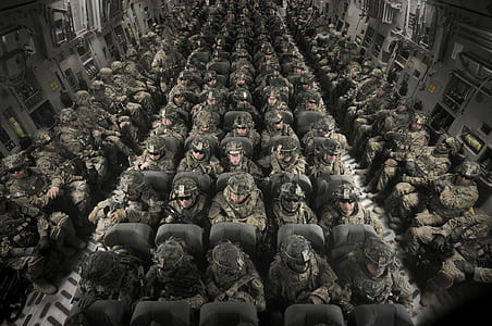 photo of soldiers riding in cargo plane