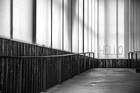 grayscale photograph of hello wall art