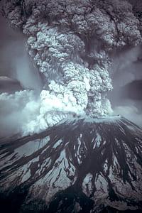 grayscale photo of volcanic eruption