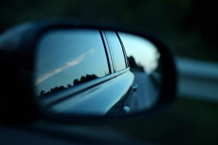 tilt shift view of car side mirror