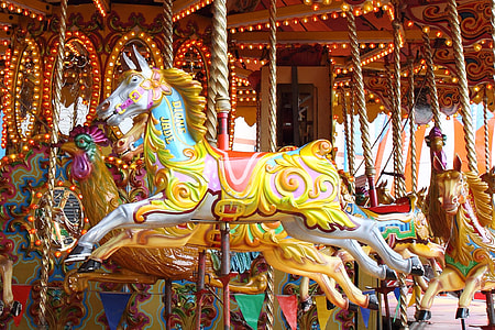 white-and-multicolored horse carousel