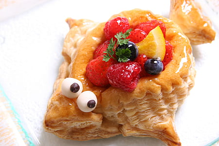 fish-shaped pie with raspberries and blueberries topping