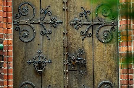 black metal and brown wooden gate
