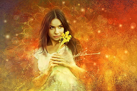 woman holding yellow petaled flower