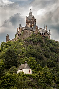 gray and brown castle on top of mountain