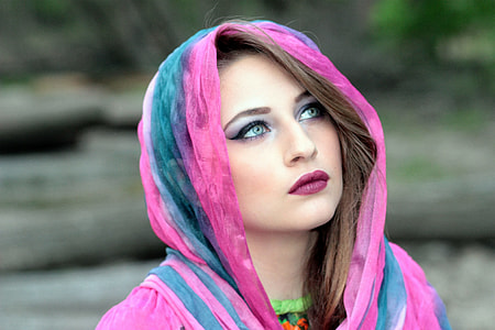 woman in pink and green hijab scarf