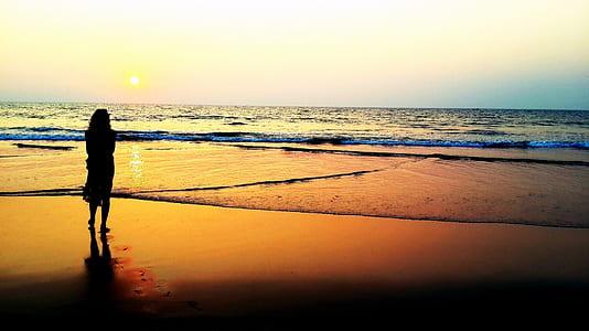 woman near beach during sunset