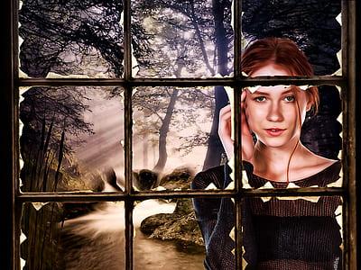 woman wearing black long-sleeved shirt outside window painting