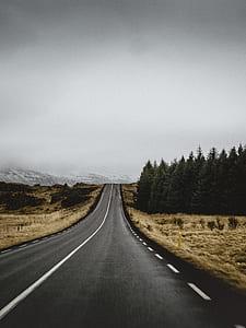 concrete road under dim sky