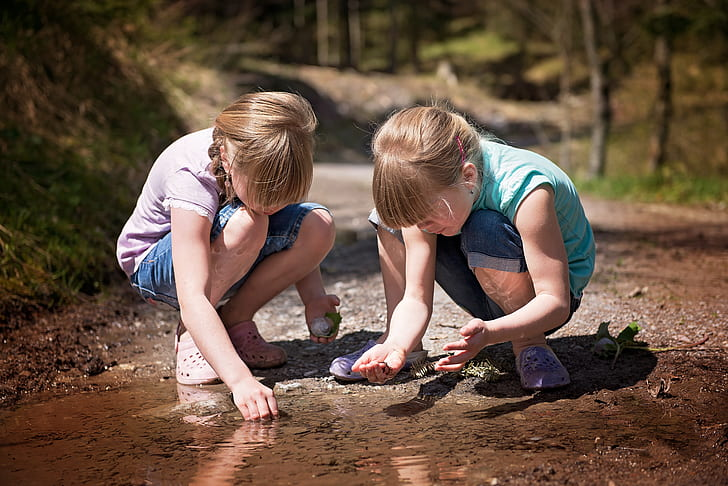 two girls crouching