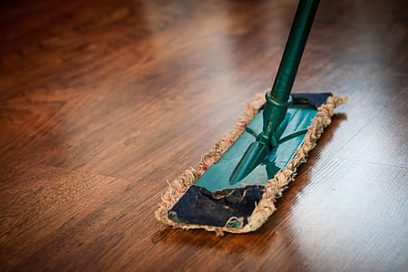 teal and brown floor mop on the floor