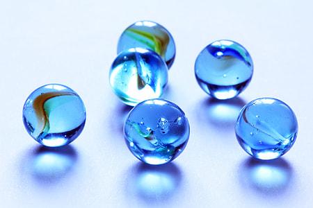 six blue marbles