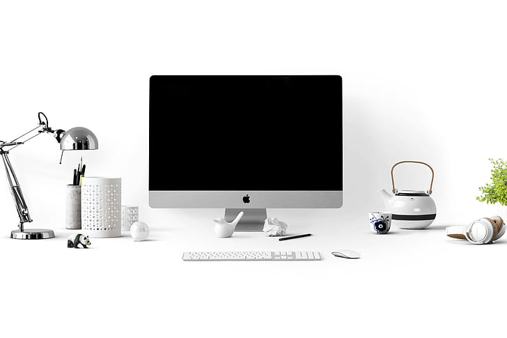 Royalty-Free photo: Apple desktop computer setup with white ...