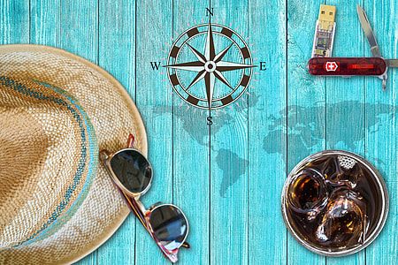sun hat, sunglasses, and pocketknife flat lay photography