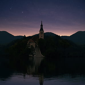 photography of castle near in lake