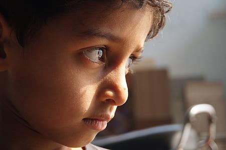 focus photography of boy face
