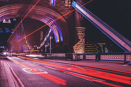 Traffic and car light trails on Tower Bridge in London