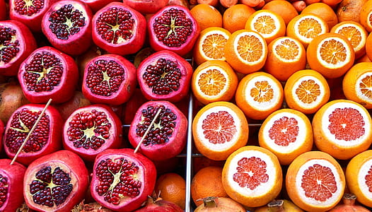 two round red and orange fruits
