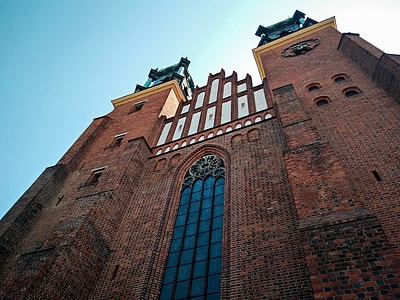 low angle architectural photography of brown brick building