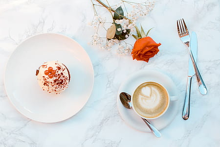 flat lay photography of cappuccino and round cake