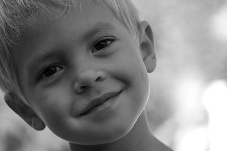 grayscaled photo of boy
