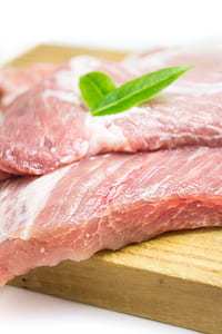 raw meat on brown wooden meat