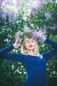 woman wearing blue long-sleeved shirt with purple flowers