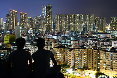 Silhouette of 2 Person on Top of the Building during Nighttime