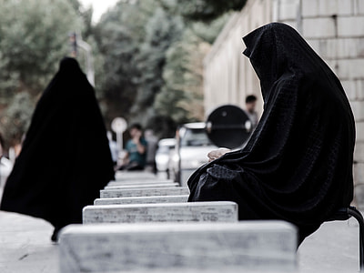 woman in black abayas outside during daytime