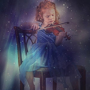 girl playing violin sitting on chair