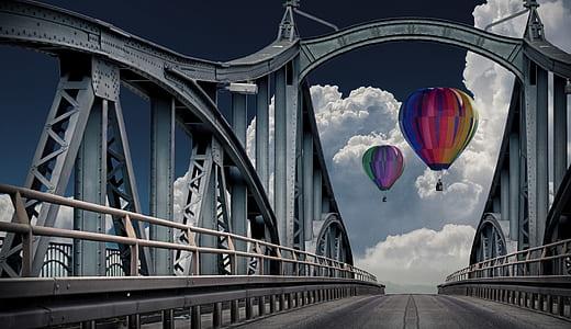 two multicolored hot air balloons near bridge