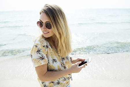 woman in white and black floral top