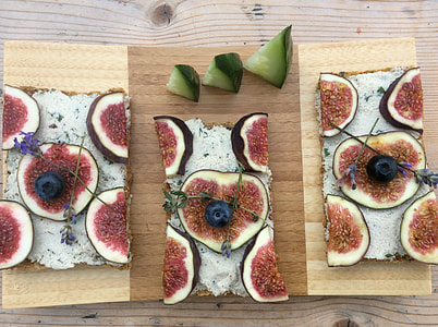 sliced fruits and vegetables on wooden plates
