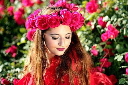 woman wearing pink rose headdress and red top