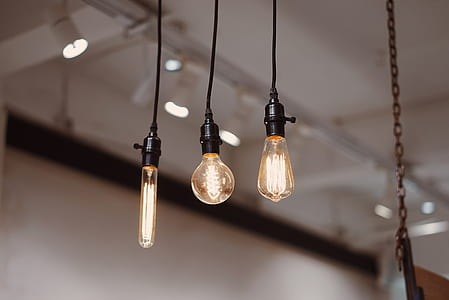 shallow focus photography of three pendant lamps