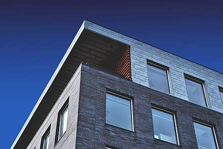 grey concrete building with glass windows