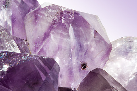 purple gemstone in macro shot