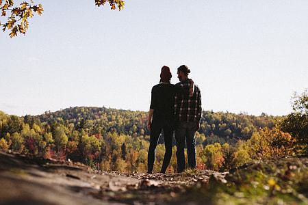 two person on mountains peak