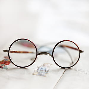 photo of round eyeglasses with brown frames