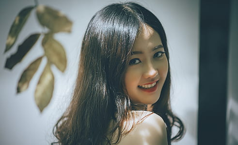 Woman with Black Long Hair Smiling